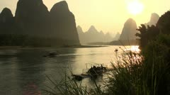 China karst scenery beautiful landscape river touring boating sunset Stock Footage