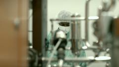 Male researcher checking equipment in biotech industry Stock Footage