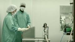 People, staff and researchers checking equipment in biotech industry - stock footage