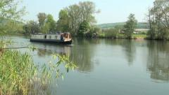 Narrow Boat on the River Thames, Oxfordshire Stock Footage