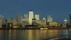 Stock Video Footage of Full Moon Time Lapse of London's Canary Wharf with River Thames