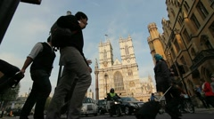 People walking across road at Westminster Abbey Stock Footage