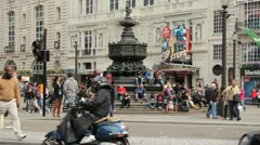 Picadilly Square crowd of people milling about Stock Footage