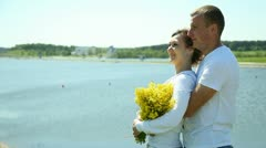 Young couple on the beach Stock Footage