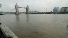The Tower bridge from the riverbank of the Thames. - stock footage