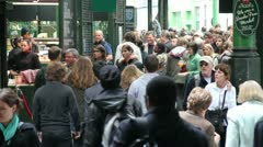 Borough market medium shot people milling around Stock Footage
