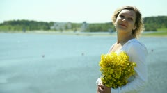 Girl with flowers on the beach Stock Footage