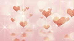 Pink hearts dangling on strings and glares loop Stock Footage