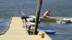 Men working on a dock in Damariscotta, Maine - stock footage