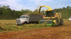 Forage Harvester and Truck - stock footage