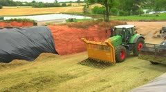 Tractors pushing Silage Stock Footage