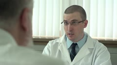 Doctor talking with patient in his office Stock Footage