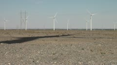 Shadow of wind turbine in deserts of Gansu, China - stock footage