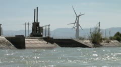 Water canal and wind farms in outlying Chinese province - stock footage