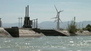 Stock Video Footage of Water canal and wind farms in outlying Chinese province