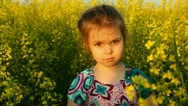 Stock Video Footage of Baby in the flowers. Laugh.