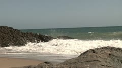 Beach view with waves crashing into large rocks nature beauty Stock Footage