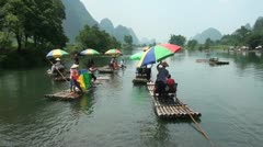 Chinese tourists on rafts in Yangshuo, a popular destination in China Stock Footage