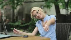 Successful businesswoman with laptop showing thumbs up, steadicam shot HD Stock Footage