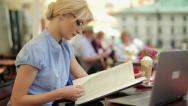 Stock Video Footage of Young businesswoman reading menu in restaurant, steadicam shot HD