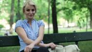 Portrait of young businesswoman in the park, steadicam shot HD Stock Footage