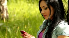 A young woman using a mobile phone Stock Footage