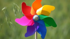 Colorful pinwheel in a field of wheat - stock footage
