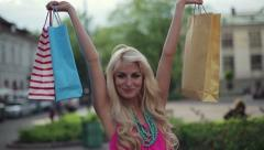 Happy woman with shopping bags in the city, steadicam shot HD Stock Footage