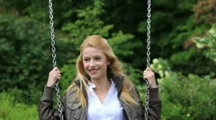 Happy young woman swinging Stock Footage