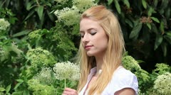 Happy young woman in spring Stock Footage