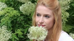 Happy young woman in spring - stock footage