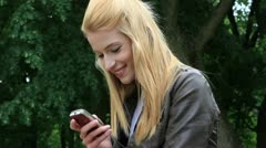Young woman with cellphone - stock footage