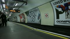 Underground train into station Stock Footage