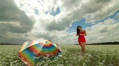 Young woman in a red dress posing Stock Footage