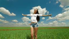 Young Woman In A Green Wheat Field Stock Footage