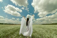 Young Woman With White Scarf In Field Stock Footage