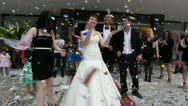 Stock Video Footage of Newlywed couple  under shower of confetti