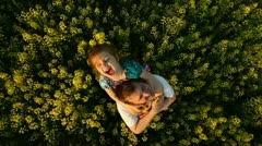 Dad and daughter in a field of flowers - stock footage