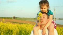 Baby in the flowers. Dad Stock Footage