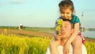 Stock Video Footage of Baby in the flowers. Dad