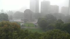 Heavy Rain in Sydney Hyde Park 01 Anzac Memorial Stock Footage
