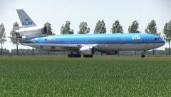 KLM MD-11 taxiing to gate Stock Footage