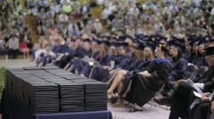 Stock Footage - College Gradutes at ceremony - Certificates and large crowd Stock Footage