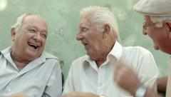 Group of happy elderly men laughing and talking - stock footage