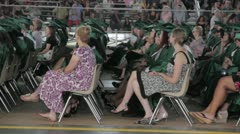 Stock Footage - High School Gradutes sitting during ceremony Stock Footage