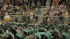 Stock Footage - High School Graduates in Green bouncing beach ball Stock Footage