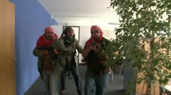 Terrorists taking hostages in office - slow motion steadicam - stock footage
