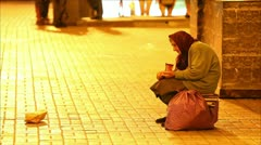 Homeless woman begging on the street Stock Footage