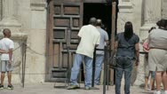 Stock Video Footage of Stock Footage - San Antonio Texas Alamo - Tourists enter front doors of mission