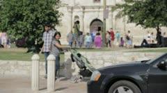 Stock Footage - San Antonio Texas Alamo street view - Famiy passes by Stock Footage